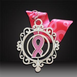 custom spinning medals breast cancer logo